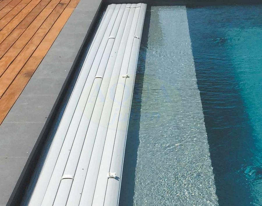 Volet roulant caillebotis immerg de piscine fc for Volet piscine immerge fond de bassin